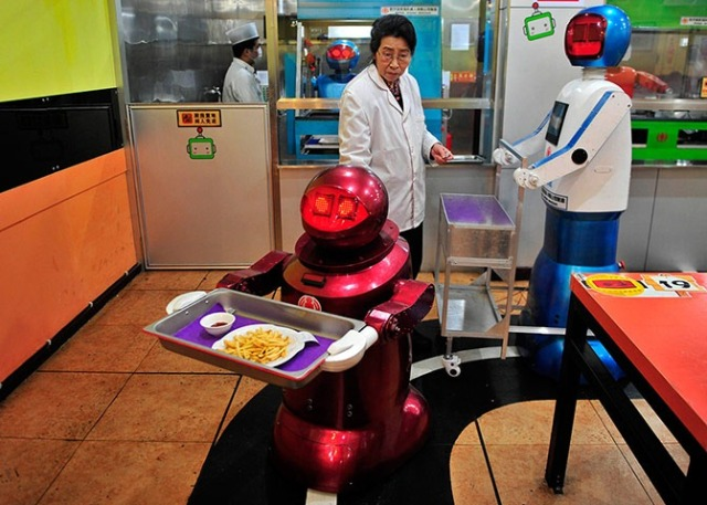 Robot delivers French fries to customers at a Robot Restaurant in Harbin